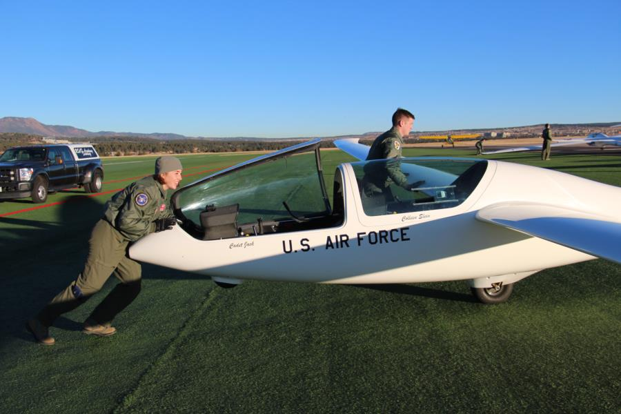 cadet pushing plane
