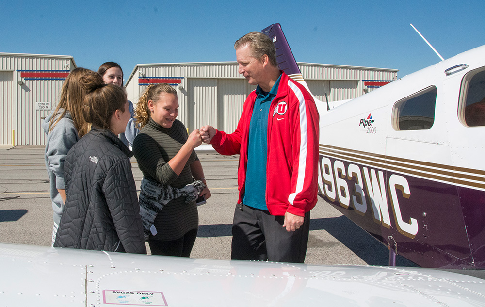 Bill Tatomer with students and planes