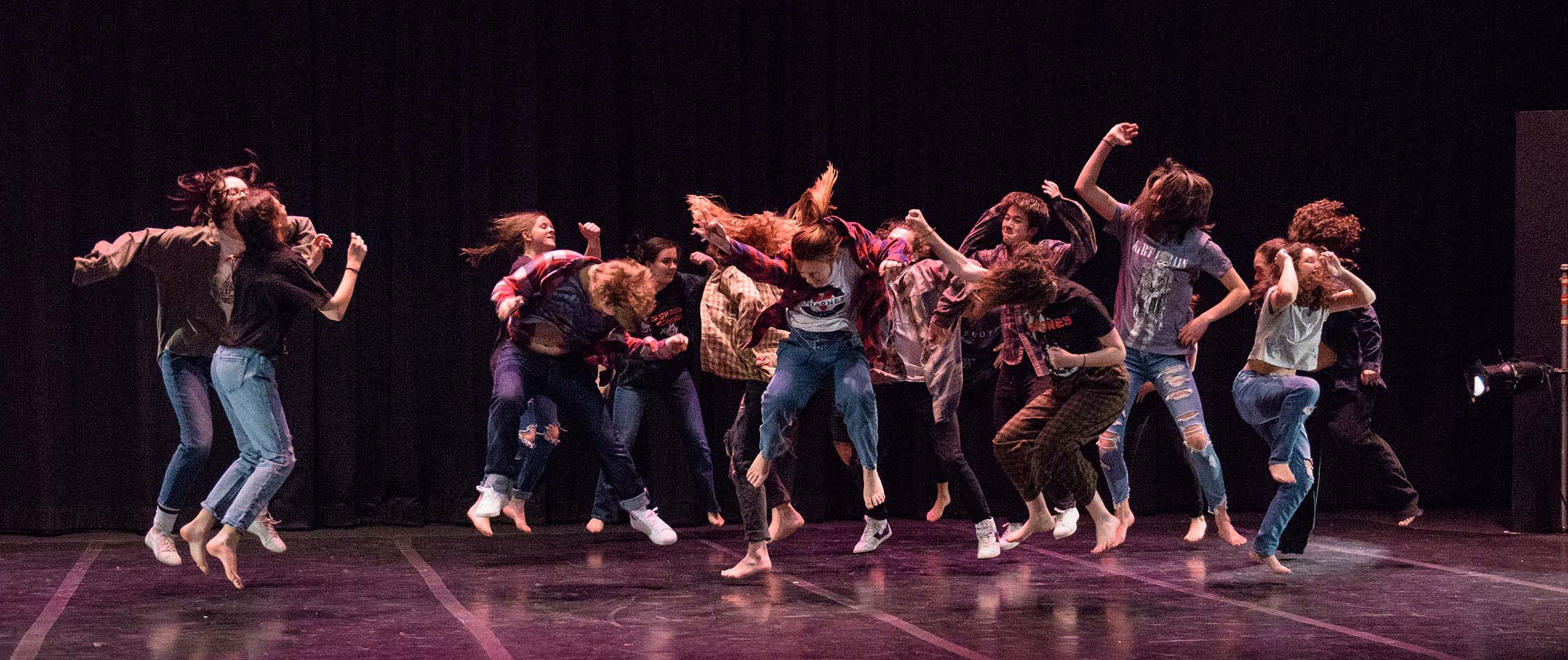 Students jump during Revolution dance concert