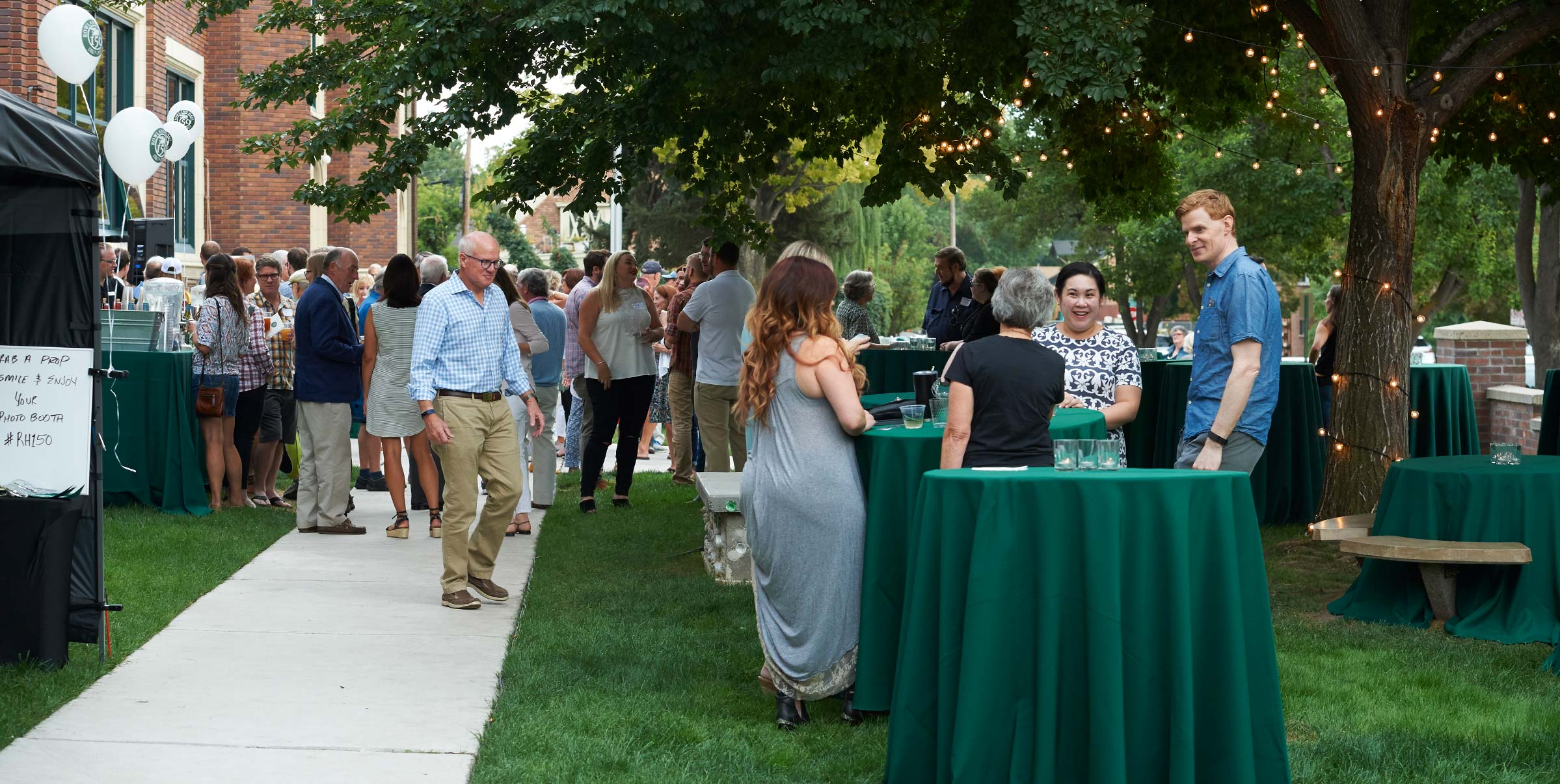 Alumni mingling outside at the fall 2017 all-class reunion for Rowland Hall's sesquicentennial